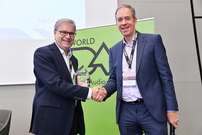 WorldDAB President Patrick Hannon presents the 2017 Award for Outstanding Achievement to Thomas Saner
